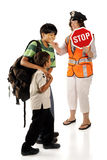 Crossing to School. Two happy brothers headed for school with the assistance of a crossing guard.  Isolated Royalty Free Stock Images