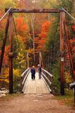 Crossing to see the autumn colors royalty free stock photo