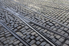 Crossing tram lines on cobblestone street in Ghent Royalty Free Stock Photo
