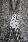 Crossing Tram Tracks. With cobblestones surrounding them Royalty Free Stock Photos