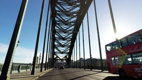 Crossing the Tyne Bridge. From Newcastle to Gateshead in North East England.  The bridge was opened in 1928 and spans the River Tyne hd, 25fps stock video
