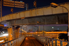 Crossing under the freeway bridge with night illumination , Bangkok, Thailand . Stock Photo