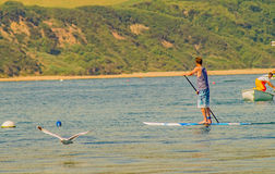 Swanage Bay Dorset, 1 June 2017, view from shore. Swanage Bay Dorset England 01 June 2017 by Boat, by Paddleboard and Flying across stock image