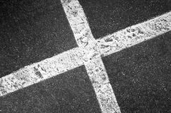Crossing white lines on black asphalt, parking lot Royalty Free Stock Photo