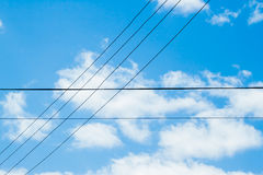Crossing wires on sky background Stock Images
