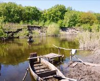 Crossing on a wooden punt-boat through the river Samara. Ukraine.  Royalty Free Stock Image