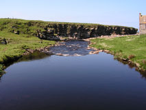 Crosskirk Landscape. A view of Crosskirk Bay, Caithness, Scotland. Home of St. Marys Chapel built 12th century. Fields & River Stock Image