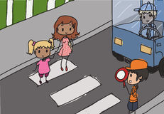 Crossover. Mother and child cross over a crosswalk Stock Image