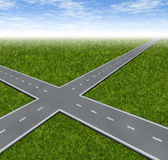 Crossroad Decision Dilemma. With two roads crossing as a business symbol of facing difficult financial choices deciding to choose the best path to success and Stock Image