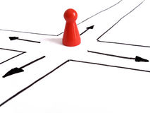 At the crossroad. Game figurine at crossroad, symbolizing the need to make a decision Stock Photos