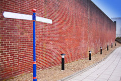 Crossroad near brick wall Royalty Free Stock Image