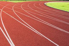 Crossroad on the red track of athletics stock images
