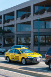 Taxi on the Embarcadero street in San Francisco. Traffic on the road in San Francisco. Crossroad in San Francisco with a cars in traffic royalty free stock images