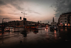 Crossroad in Warsaw. A crossroad in Warsaw with moving vehicles after heavy rain Stock Photos