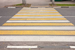 Crossroad with yellow and white stripes Stock Image