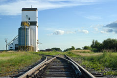 Crossroads. A crossroad section of the railroad tracks with one side going to a grain elevator and the other going straight and disappearing in the distance Stock Images