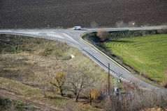 Crossroads. Infrastructure. Junction of roads, railway and wiring Royalty Free Stock Images