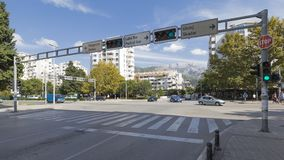 Crossroads in Bar in Montenegro. Bar - September 30, 2017: Automobile traffic on Vladimira Rolovića street, pedestrian crossing and mountains away September 30 Royalty Free Stock Photos