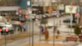 Crossroads in the city in the evening. Accelerated motion. Traffic lights, billboards, traffic and pedestrians. Bokeh. Defocused lens. Time-lapse recording stock video footage
