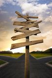 Crossroads with confusing directional arrow sign. Concept of being lost with a roadsign Royalty Free Stock Photos