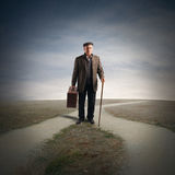 Crossroads. Elderly man at a crossroads of streets royalty free stock photo