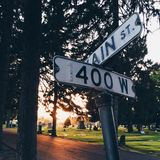 Crossroads in Graveyard. A graveyard with two signs telling visitors which way to travel Stock Photos