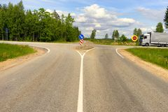 Crossroads on the highway in summer. Crossroads of asphalt roads with road signs and a truck in years stock image