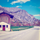 Crossroads. Little Church Near the Crossroads in the Italian Alps, Instagram Effect royalty free stock image