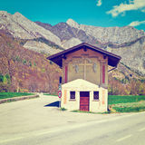 Crossroads. Little Church Near the Crossroads in the Italian Alps, Instagram Effect stock photography
