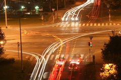 Crossroads in the night. Multiple overlay-ed images of crossroads royalty free stock photography