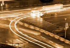 Crossroads night traffic urban. Night urban city scene: crossroads at Moscow (Russia) with cars driving to different direction forming an abstract light pattern Royalty Free Stock Image