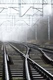 Crossroads of railway tracks in the fog.  royalty free stock image