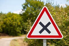 Crossroads road sign on a country road Stock Image