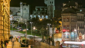 The crossroads with the Sao Bento Railway Station and Porto Cathedral timelapse. The crossroads  with the Sao Bento Railway Station and Porto Cathedral night stock video footage