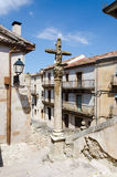 Crossroads. Sepulveda. Stone cross on a street in the city of Sepulveda, Province of Segovia, Spain Royalty Free Stock Image