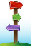 Crossroads Sign. Cartoon crossroads sign with blue sky on green grass Royalty Free Stock Images
