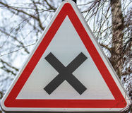 Crossroads sign, France. Danger Crossroads sign in France Royalty Free Stock Images