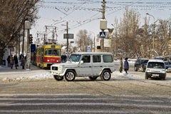 At the crossroads in the snow-covered city. Tram stop street of Marshal Rokossovsky Royalty Free Stock Photo