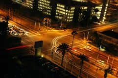 Crossroads Traffic. Traffic turning at a light signal at night Royalty Free Stock Photography