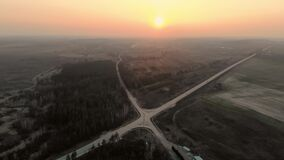 Crossroads of two roads at sunset time, aerial view.4k.