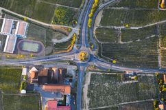 Crossroads with vineyards and sunset lights royalty free stock photo