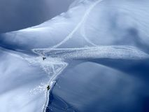 Crossroads in the snow. Crossroads of walking tracks at Aguille Du Midi for trekkers in the French Alps stock image