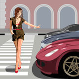 Crosswalk. The beautiful girl passes street on a pedestrian crossing Stock Image