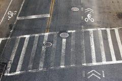 Crosswalk and Bike Lanes in NYC. City street crosswalk and bike lanes in New York City stock photography