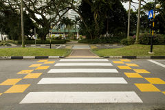 Crosswalk. The building looks across the street in Singapore Royalty Free Stock Photo