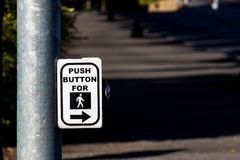 Crosswalk button mechanism on a steel post Royalty Free Stock Image