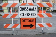 Crosswalk closed and detour signs royalty free stock images