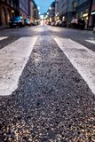 Crosswalk closeup in a city by night royalty free stock photography