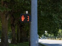 Crosswalk hand symbol sign on a post royalty free stock photo
