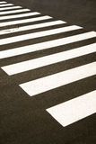 Crosswalk markings painted on the asphalt in the city Royalty Free Stock Photos